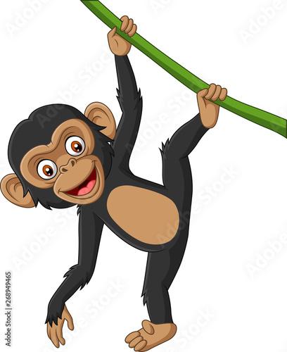 Fotomural Cartoon baby chimpanzee hanging in tree branch