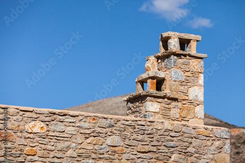 Fotografiet Stone amde chimney on roof
