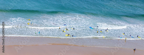 Foto op Plexiglas Noord Europa Surfers in the waves off Mawgan Porth Beach, Cornwall, UK