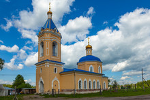 Restored Ancient Orthodox Church With A Blue Roof And Golden Domes