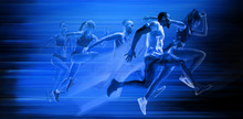 Young African-american And Caucasian Men And Women Running Isolated On Blue Studio Background. Silhouette Of Jogging Athletes With Shadows In Neon Light. Movement Or Motion. Creative Collage.