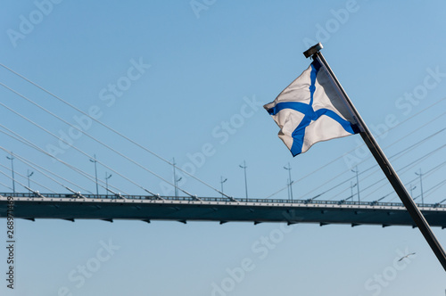 Russian naval flag on the background of cable-stayed bridge in Vladivostok throu Fototapeta