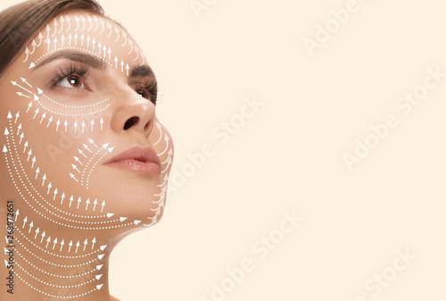Fotografie, Obraz  Beautiful female face isolated on studio background