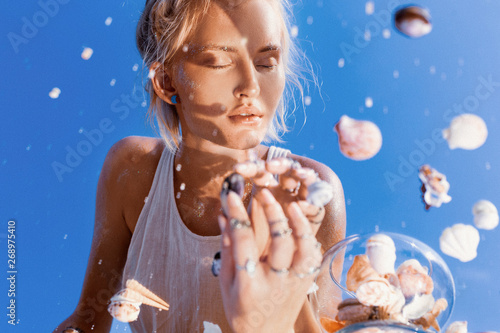Fotografija  beautiful young woman model reflection in mirror portrait with sea shells