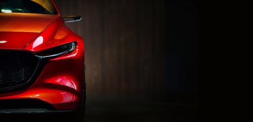 Red modern car headlights on black background