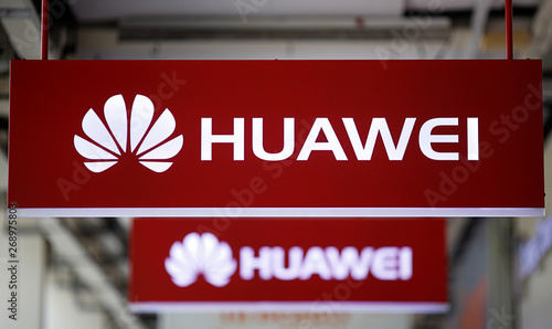 Huawei signage are pictured at a mobile phone shop in