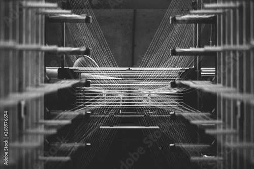 Textile factory machine weaving close up Fototapeta