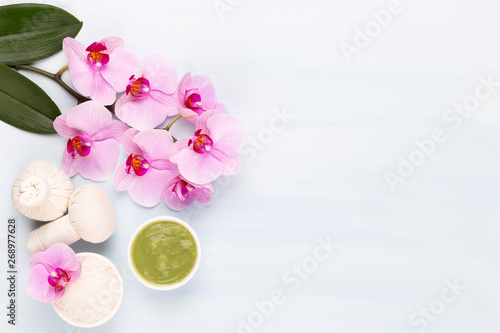 Foto op Plexiglas Spa Sea salt, aromatherapy oil in bottles and orchid on vintage wooden background.