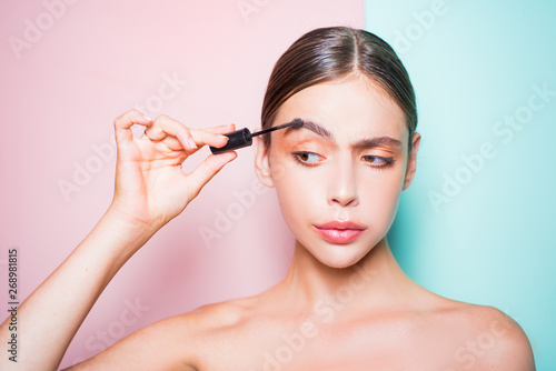 Beauty routine. Girl hold cosmetic applicator. Woman put makeup on her face. Daily makeup concept. Makeup and cosmetics. Girl healthy shiny skin put makeup on. Add more details. Fashion model