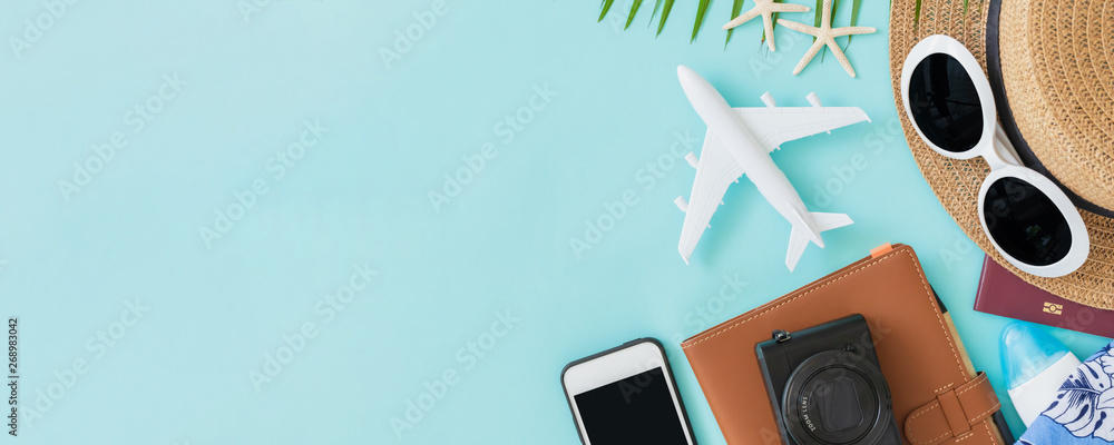 Fototapety, obrazy: Top view of traveler accessories, tropical palm leaf and airplane on blue background with empty space for text. Travel summer holiday vacation banner concept.