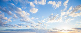 Fototapeta Na sufit - Blue sky clouds background. Beautiful landscape with clouds and orange sun on sky