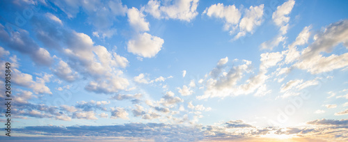 Blue sky clouds background. Beautiful landscape with clouds and orange sun on sky - 268985849