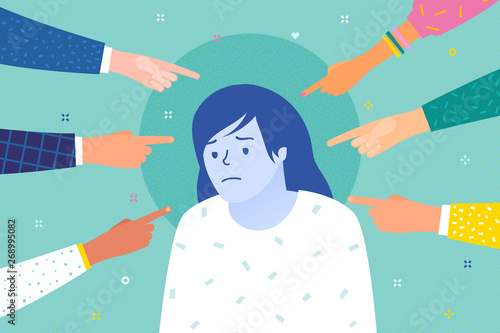 Valokuva  Sad or depressed woman surrounded by hands with index fingers pointing at her