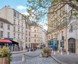 Streets of Paris, France. Blue sky, buildings and traffic.