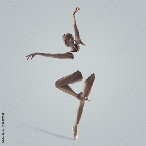 Graceful ballet dancer or classic ballerina dancing isolated on studio background. Woman's beautiful dance. The grace, artist, contemporary, movement concept. Abstract design. Wall mural