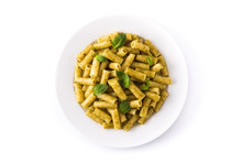 Penne Pasta With Pesto Sauce And Basil On A Plate Isolated On White Background. Top View