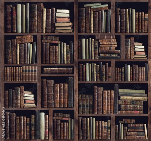 Collection of valuable ancient books on a bookshelf Canvas Print