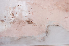 Old Weathered Painted Wall Background Texture. White Dirty Peeled Plaster Wall With Falling Off Flakes Of Paint.