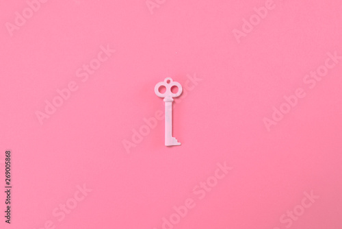 Pink key lie on pastel pink background. Minimal summer concept. - 269005868