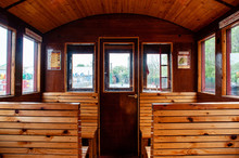 Vintage Train Salon Inside. Old Wooden Benches In The Train In The Interior.