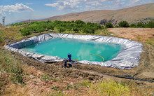 Irrigation Reservoir With Pipe...