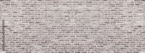 Poster Brick wall Wide light red shabby brick wall texture. Old masonry panorama. Whitewashed rough brickwork panoramic vintage background