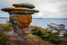 Colorful Lichen Covered Monolithe In Mingan Archipelago National Park Reserve, Quebec, Canada.