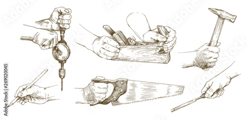 Carpenter hands working with a chisel and carving tools. Fototapete