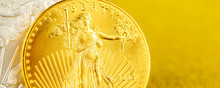 Silver Eagle And Golden American Eagle One Ounce Coins On Golden Background