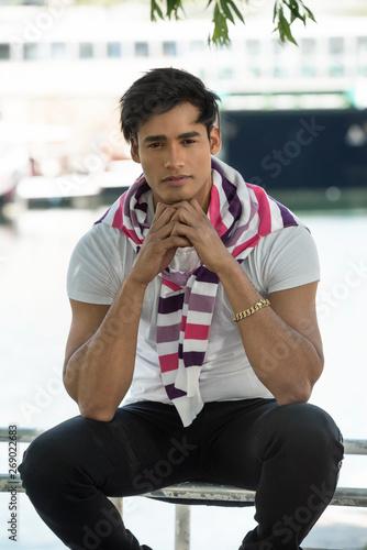 Платно Fashion portrait of young handsome man. Street fashion concept.