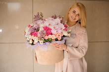 Blond Girl With Big Bouquet In Hat Box