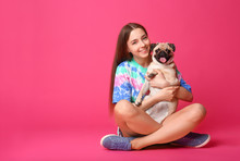 Teenage Girl With Cute Pug Dog On Color Background
