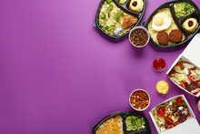 Containers With Delicious Food On Color Background