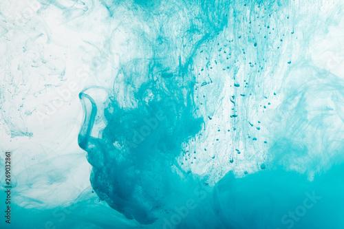 Fototapeta Close up view of blue paint swirls in water obraz