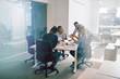 canvas print picture - Work colleagues discussing business together during an office me