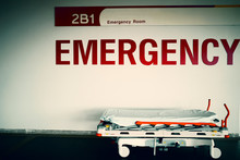 Red Emergency Room Sign And Pa...