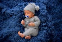 Sleeping Newborn Boy In The Fi...