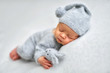 canvas print picture - Sleeping newborn boy in the first days of life on white background