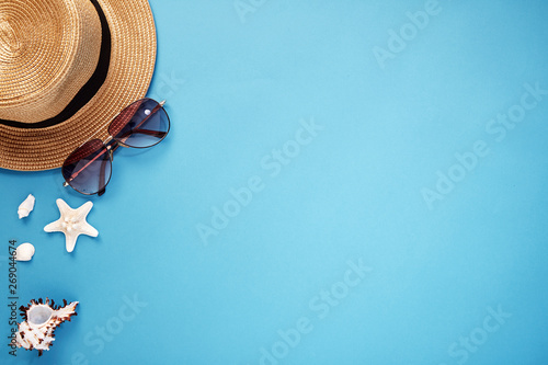 Fototapeta hat smartphone and sunglasses blue background obraz na płótnie