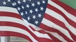 American flag flowing in breeze. Flag blowing to right in frame, clipped at top