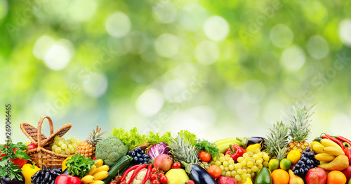 Poster Cuisine Fruits, vegetables, berries on green natural blurred background.
