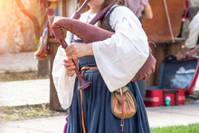 The Girl Plays A Musical Instrument Bagpipe, Close Up View.