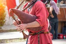 A Man Plays A Musical Bagpipe,...