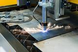Automatic CNC plasma cutting machine cuts details from steel sheet. - 269047829