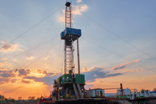 Oil Rig For Drilling Under Oil And Gas At Sunset. Drilling Oil And Gas Wells