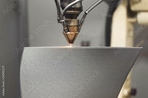 Fotografie, Obraz  3D metal printer produces a steel part.