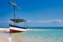 Fisherman Boats Typical Of The Coasts Of Vilanculos, Mozambique. Moored On The Shore Of The Beach Landscape. Vilankulo