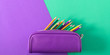 Leinwanddruck Bild - Back to school. Colorful minimal composition of school supplies on green and purple background. Flat lay, top view, copy space