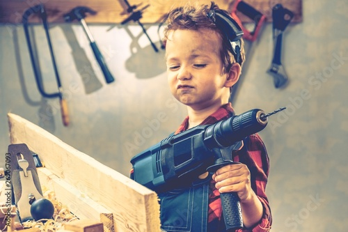Child fathers day concept, carpenter tool,  worker. Canvas
