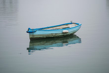Small Boat On Clam Water With ...